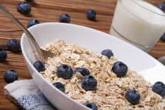 Oatmeal with blueberries and milk in a glass horizontal Royalty Free Stock Image