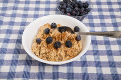 Oatmeal with Blueberries and Spoon Stock Photos