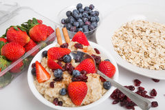 Oatmeal with Blueberries Strawberries Cranberries and Cinnamon w royalty free stock photography