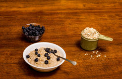 Oatmeal with Blueberries on Wood Table Stock Photography
