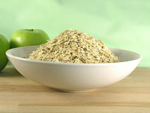 Oatmeal in bowl. Oatmeal on green background Royalty Free Stock Photos