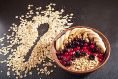 Oatmeal in bowl with berries, bananas and walnuts Stock Photo