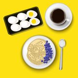 Oatmeal in a bowl with blueberries, the cup of coffee and the boiled eggs. Top view. Healthy natural breakfast. stock images