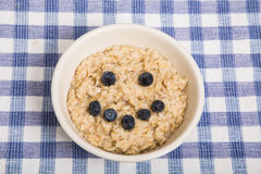 Oatmeal in Bowl with Blueberry Smiley Face Stock Photos