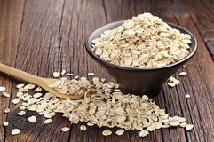 Oatmeal in bowl and near Royalty Free Stock Photos