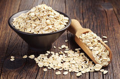 Oatmeal in bowl and scoop Stock Photo