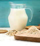 Oatmeal and bran on a wooden board Royalty Free Stock Images