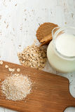 Oatmeal and bran on a wooden board Stock Images
