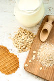 Oatmeal and bran on a wooden board Stock Photo