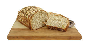 Oatmeal Bread Loaf and Slices Royalty Free Stock Images