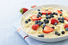 Oatmeal breakfast cereal with berries Stock Photos