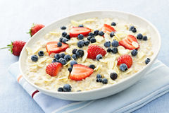 Oatmeal breakfast cereal with berries stock images