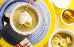 Oatmeal Breakfast with golden shadow. Organic stock image
