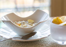 Oatmeal breakfast in modern white bowl Royalty Free Stock Image