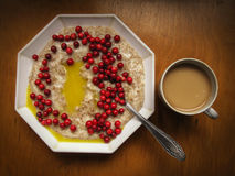 Oatmeal with butter and lingon berries Stock Images