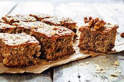 Oatmeal cake with dates and walnuts Royalty Free Stock Image
