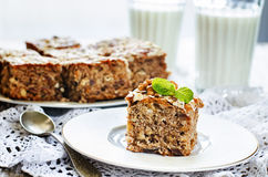 Oatmeal cake with dates and walnuts. On a light background. tinting. selective focus on mint Royalty Free Stock Photography