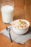 Oatmeal with candied fruils and milk Stock Photo