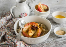 Oatmeal with caramelized apples and cinnamon in a white bowl Royalty Free Stock Photos