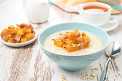 Oatmeal with caramelized peaches Royalty Free Stock Photography