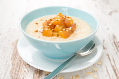 Oatmeal with caramelized peaches in a bowl close-up Stock Photography