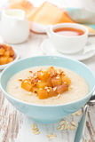 Oatmeal with caramelized peaches, close-up Royalty Free Stock Image