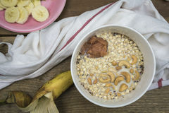 Oatmeal with cashews and applesauce Royalty Free Stock Image