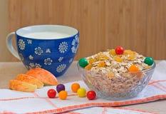 Oatmeal cereal, apple, milk, raisin, candy Stock Photography