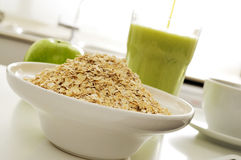 Oatmeal cereal, apple and smoothie Stock Image