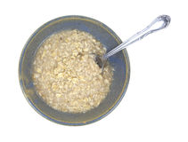 Oatmeal cereal in bowl with spoon Stock Image