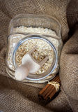 Oatmeal cereals a glass jar. Breakfast and baking concept, healthy lifestyle concept royalty free stock photography
