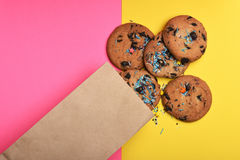 Oatmeal chocolate cookies on colorful background Royalty Free Stock Photos