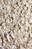 Oatmeal. Oat flakes background Stock Images