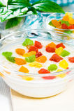 Oatmeal with colorful candied fruits in a glass bowl Royalty Free Stock Image