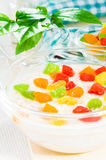 Oatmeal with colorful candied fruits Royalty Free Stock Image