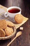 Oatmeal cookie and cup of tea Royalty Free Stock Image