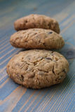 Oatmeal cookie. Three oatmeal cookies with sunflower seeds overlapping on a wooden board.  Perfect for a day trip, party, meeting over coffee Royalty Free Stock Images