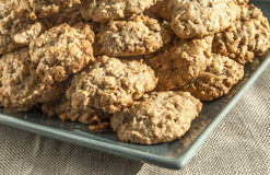 Oatmeal cookies. Homemade oatmeal cookies plate corner on linen cloth royalty free stock images