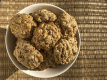 Oatmeal cookies. Homemade oatmeal cookies in bowl on reed mat closeup stock photography
