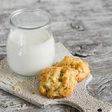 Oatmeal cookies with apples and a bottle of milk Stock Images