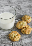 Oatmeal cookies with apples and a glass of milk Royalty Free Stock Image