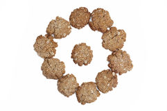 Oatmeal cookies arranged in a circle. Ten oatmeal homemade oatmeal cookies arranged in a circle, isolated on white background Stock Image