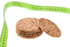 Oatmeal cookies on a background of a meter to measure. Diet for weight loss. Royalty Free Stock Photos