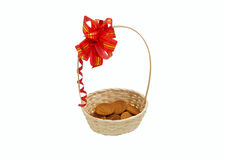 Oatmeal cookies in a basket. With a red bow Stock Photos