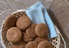 Oatmeal cookies in a basket on a wooden table. Top view stock images