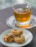 Oatmeal cookies. Breakfast with tea and fresh oatmeal cookies Stock Image