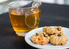 Oatmeal cookies. Breakfast with tea and fresh oatmeal cookies Royalty Free Stock Photography