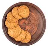 Oatmeal cookies in a brown plate. Isolated on white background. Stock Photography