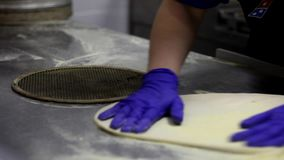 preparation of dough for pizza. Cooking pizza in a restaurant. hands of chef with gloves on stock video