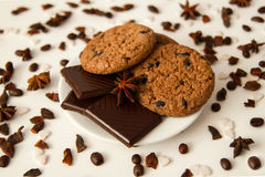 Oatmeal cookies with chocolate on the white saucer on the white background. Stock Images